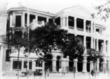 The original Shanghai Club was a three-storey red-brick building constructed by the British in 1861. The original Club was torn down and rebuilt in 1910 with reinforced concrete in a neo-classical design. The large first floor dining room had black and white marble flooring, while the entrance staircase used imported white Sicilian marble.<br/><br/>  The club was a British men's club and was the most exclusive club in Shanghai during the heyday of the 1920s and 1930s. The membership fee was $125 and monthly dues were $9. The second-floor was famous for the 'Long Bar.' This was an unpolished mahogany, L-shaped bar that measured 110.7 feet by 39 feet. On one side of the bar was a smoking room and library, while on the other side was a billiards room. It was famous for being the world's longest bar at one time. Noel Coward said, laying his cheek on it, that he could see the curvature of the earth.<br/><br/>  There were also forty guest rooms on the second and third floors. It later became the Dongfeng Hotel, and even housed a KFC restaurant from 1990 to 1996. The restored building as of October 2010 is the Waldorf Astoria Shanghai, a luxury hotel.