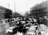 The Yang King Pan Canal ran between the French and International Concessions in Shanghai, and was the scene of much busy commerce and a crowded market.