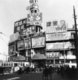 Shanghai's Da Shijie or Great World entertainment centre, past its 1930s prime and covered in advertising hoardings, in 1948.